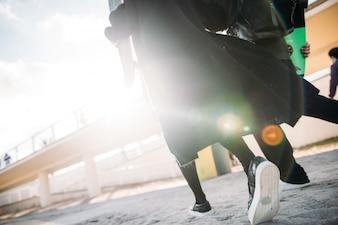 Women walking with skateboards