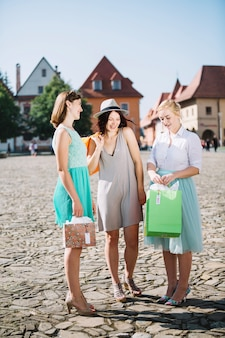 Women with buyings in town