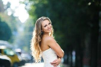 Wonderful bride posing in sunlight