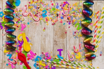Wooden background with confetti and streamers around