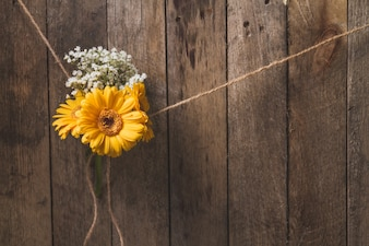 Wooden background with flowers tied