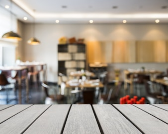 Wooden board looking out to tables in restaurant