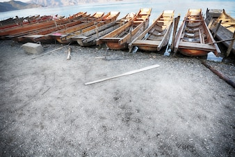 Wooden boats parked on the shore