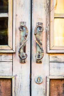 Wooden door with rusty handles