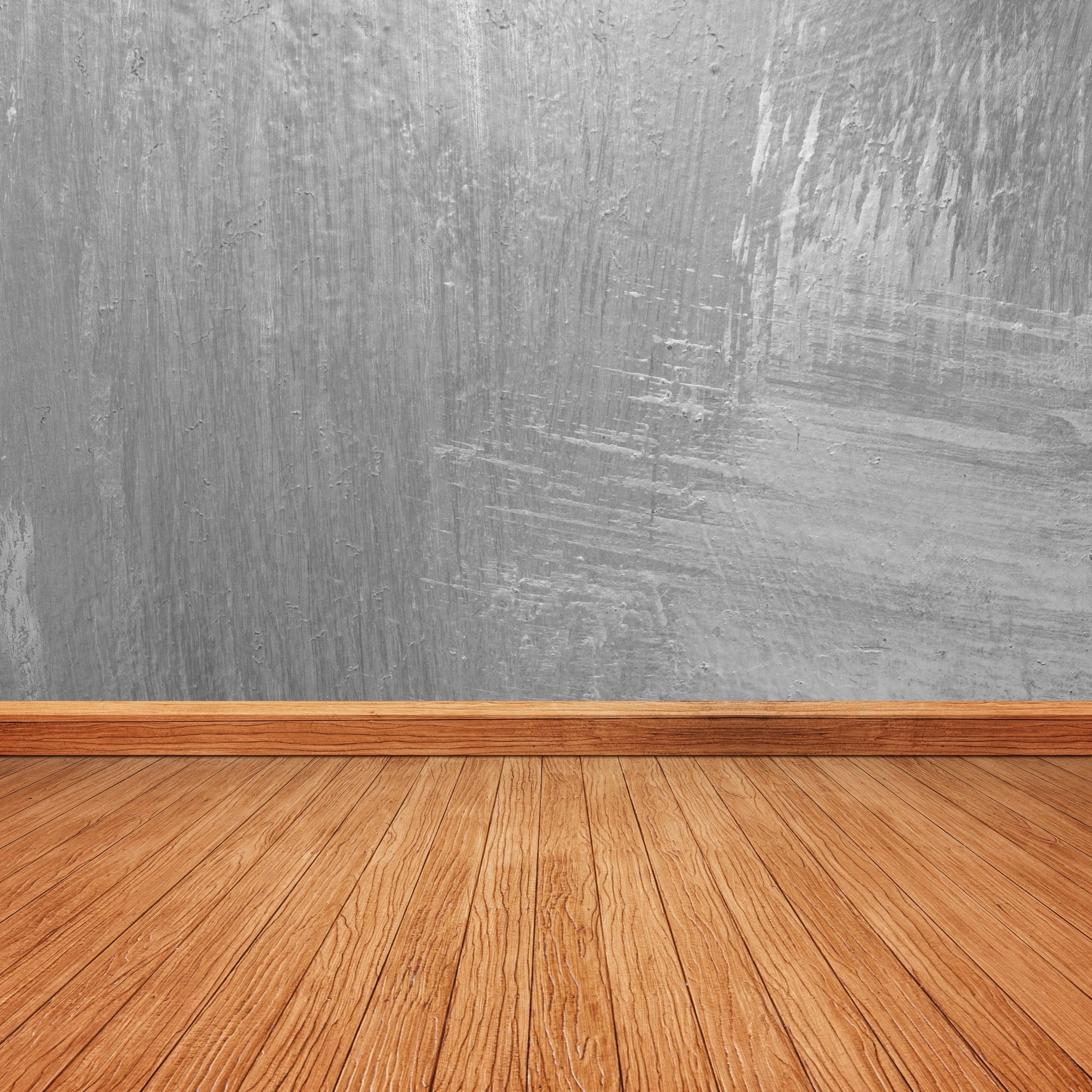 Wooden floor with a concrete wall