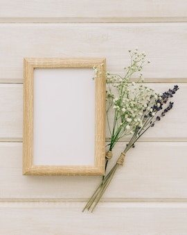 Wooden frame with a couple of bouquets of flowers