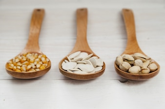 Wooden ladles full of seeds and nuts