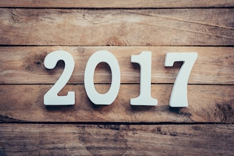 Wooden numbers forming the number 2017, For the new year 2017 on a rustic wooden background.