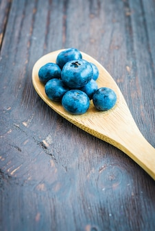 Wooden spoon with blueberries