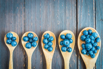 Wooden spoons with blueberries