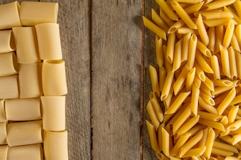 Wooden surface with different types of macaroni