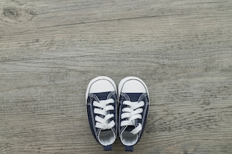 Wooden surface with small shoes