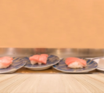 Wooden table top with Blurred sushi background
