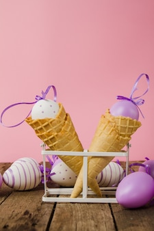 Wooden table with cones and easter eggs