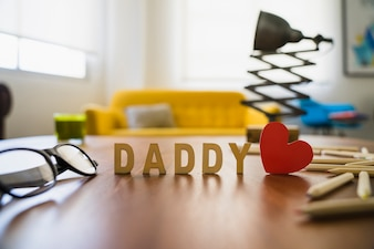 Wooden table with father's day elements