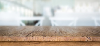 Wooden table with unfocused background