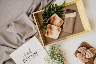 Wooden tray with breakfast and template