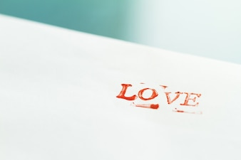 Word  love  set with a stamp on a paper