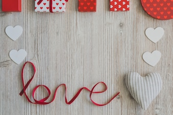 Word  love  with a fabric heart and red gifts