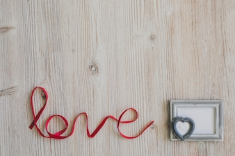 Word  love  with a gray photo frame
