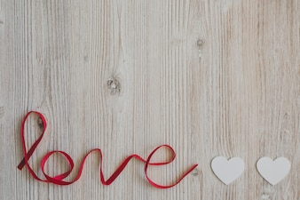 Word  love  with two paper hearts