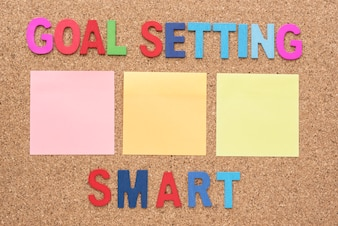 Words goal setting and smart with blank notepad