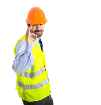 Worker making Ok sign