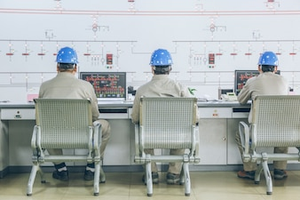 Workers in control room