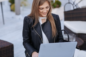 Working woman looking at a laptop