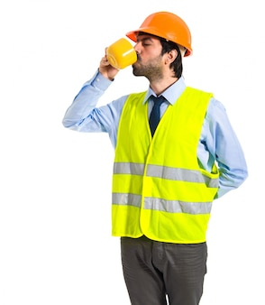 Workman holding a cup of coffee