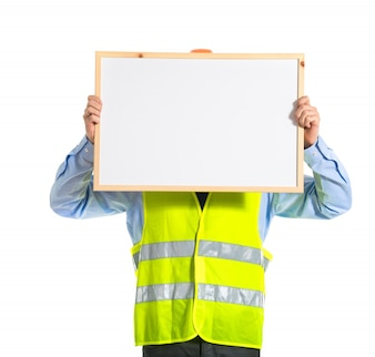 Workman holding empty placard