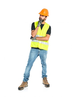 Workman thinking over isolated white background