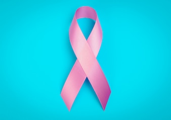 World cancer day : Breast Cancer Awareness Ribbon on blue Backgr