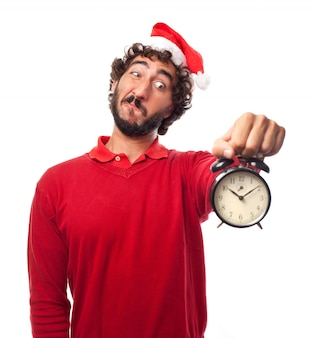 Worried man holding his vintage clock