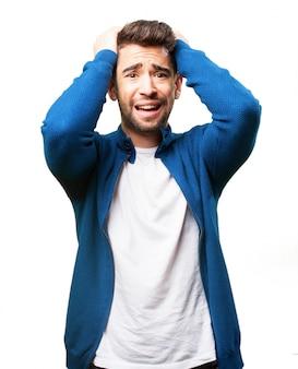 Worried man pulling his hair