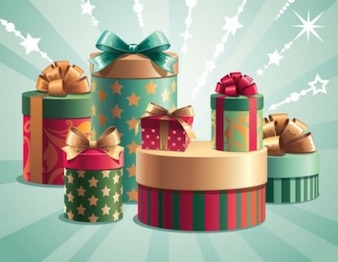 Wrapped cylinder gift boxes on green background