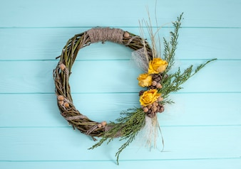 Wreath from a vine with roses. Handmade decor.Wreath of real twigs on a wooden background