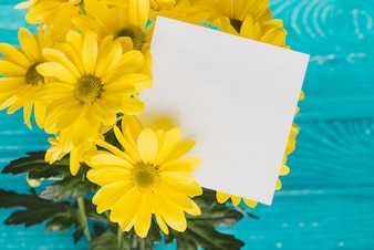 Yellow daisies with blank note