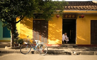 Yellow wall and blue bicycle