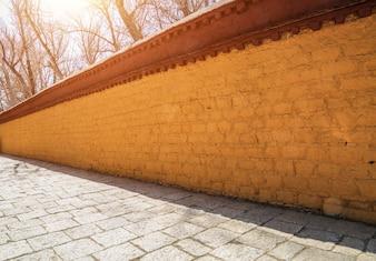 Yellow wall made of bricks