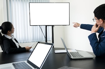 Young Businessman working a video conference using a desktop computer of the blank screen.