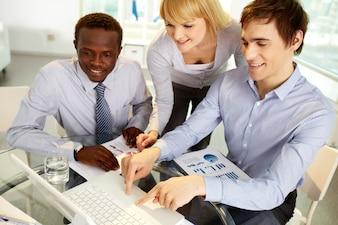 Young colleague laptop businessman business