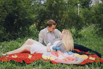 Young couple looking at each other sitting on the grass