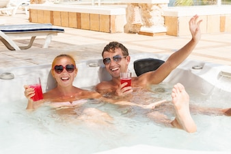 Young couple relaxing in jacuzzi pool