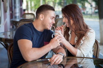 Young couple sharing a milkshake