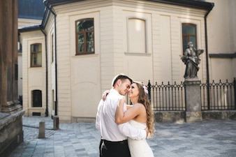 Young couple smiling while embracing