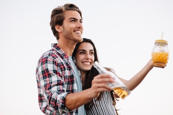 Young couple with drinks