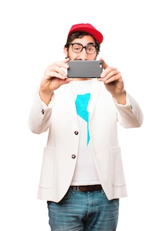 Young crazy businessman with a mobile phone