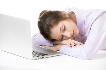 Young employee sleeping while working