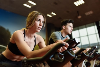 Young equipment working fitness spin